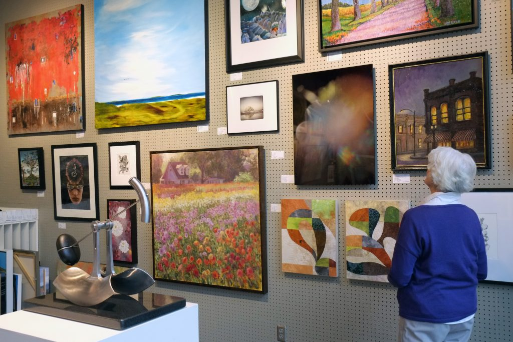 Woman admiring artwork in the gallery