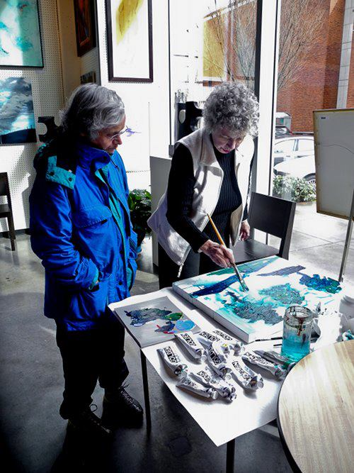 Artists Janet Holt and Sidonie Caron giving a demo in the gallery.